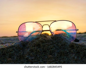 sunglasses on the beach in summer day