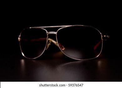 Sunglasses on black background