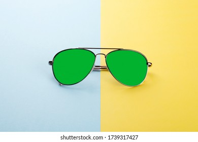 Sunglasses on blue yellow background as concept protect eyes from uv lights.