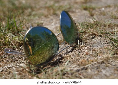 Sunglasses on the ground