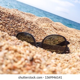 Sunglasses on the sand beach