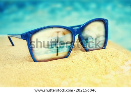 44e32a8ca4a2 Sunglasses On Sand Beach Stock Photo (Edit Now) 282156848 - Shutterstock