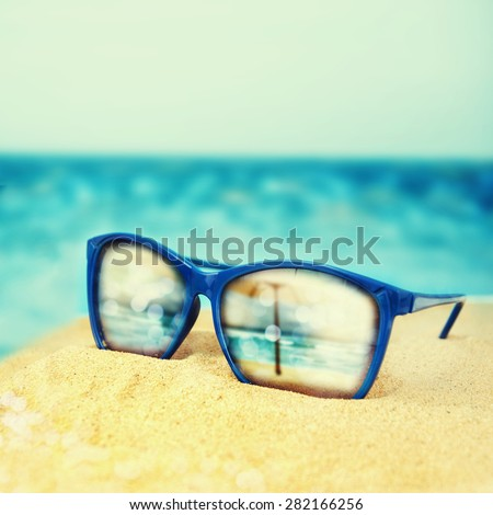8294e3cd2a2a Sunglasses On Sand Beach Stock Photo (Edit Now) 282166256 - Shutterstock