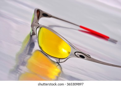 Sunglasses on the silver background