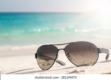 Sunglasses on the tropical beach. Travel relax vacation - azure sea, white sand, shining sun, Summer paradise day on exotic bay Grand Anse, La Digue Island, Seychelles, Indian Ocean