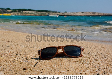 b978152ee0db Sunglasses On Wet Sand Beach Stock Photo (Edit Now) 1188775213 ...