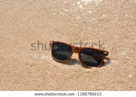 05b8ca51a587 Sunglasses On Wet Sand Beach Stock Photo (Edit Now) 1188780613 ...