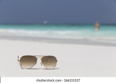 Sunglasses on white sand beach. Similan Islands, Thailand.