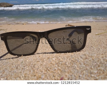 d9fcae1b0fdf Sunglasses On White Sand Beach Stock Photo (Edit Now) 1212815452 ...