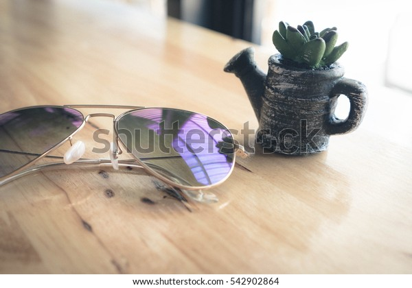 Sunglasses on the wooden table ,old color