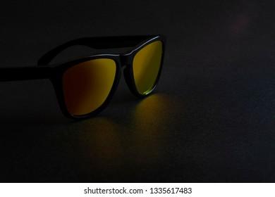 Sunglasses with Orange Mirrored Reflective Lenses