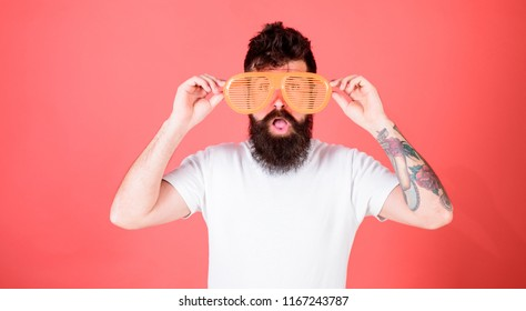 Sunglasses party attribute and stylish accessory. Hipster wear shutter shades sunglasses. Man bearded hipster wears giant louvered sunglasses. Eye protection accessory concept. Fashionable accessory.