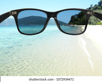 Sunglasses with polarized lens over sea-view background , protection eyes from ultraviolet ray.