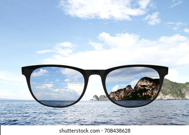 Sunglasses with polarized lens over sea-view background
