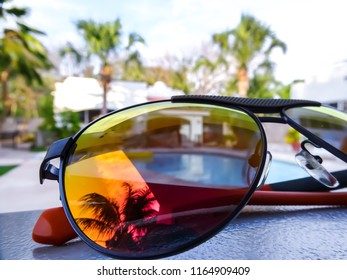 sunglasses with reflection in beach