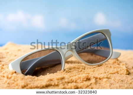 71ed20b4859f Sunglasses Sand Beach Stock Photo (Edit Now) 32323840 - Shutterstock