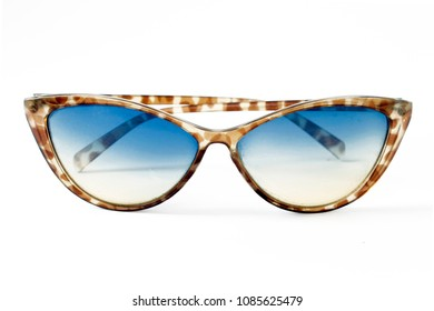 Sunglasses in the shape of cat's eye, women's fashion, leopard frame in black and brown, transparent crystals with blue tones, white background.
