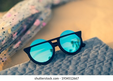 Sunglasses special model with big blue lenses for ladies with special design shoot outdoors closeup. Selective focus