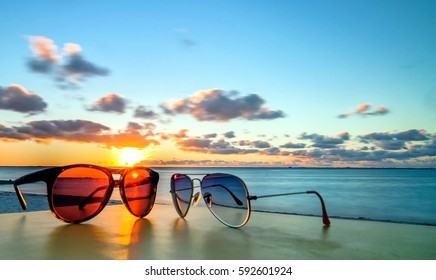 sunglasses at sunset on famous tropical Playa del Norte beach in Isla Mujeres, Mexico