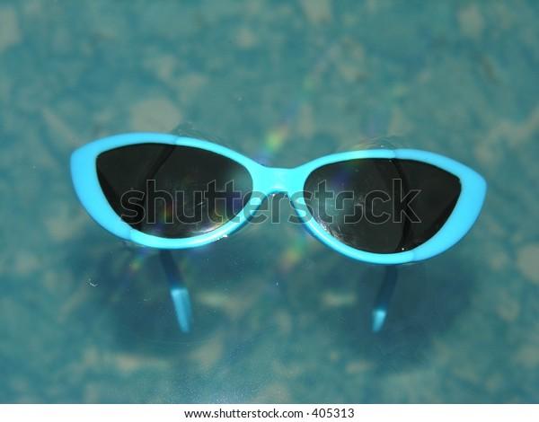Sunglasses in swimming pool