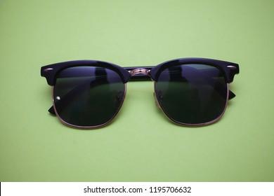 sunglasses vibrant background green