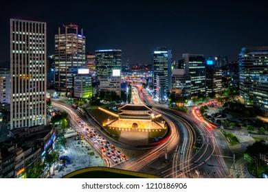 Sungnyemun gate (Namdaemun Market) or Namdaemun gate with light trails of car at night in Seoul, South korea.