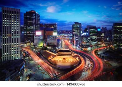 Sungnyemun Gate or Namdaemun Gate at Namdaemun market with light trails of car at night in Seoul, South Korea