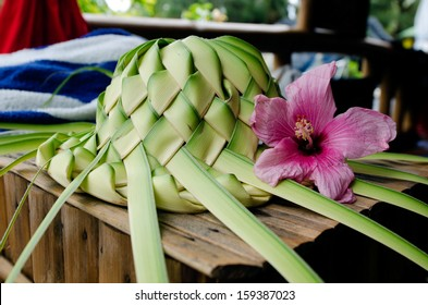 Sunhat knees out of palm leaves in Rarotonga, Cook Islands.