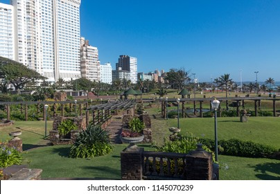 Sunked gardens against Golden Mile beachfront city skyline and blue sky in Durban, South Africa