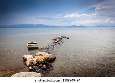 A sunken bark at the rocky coastline of the greek peninsula Pilion