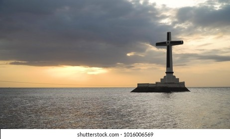 Sunken Cemetery cross in Camiguin Island, Philippines. Large crucafix marking the underwater sunken cemetary of the coast of camiguin island near mindanao in the Philippines. Catholic cross in the