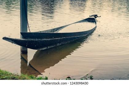 sunken fishing boat in thailand (cross process)