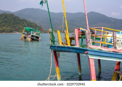 Sunken fishing boats near Koh Chang island in the Gulf of Thailand .