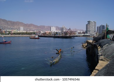 Sunken fishing vessel between the historic pier and the fishing terminal inside the city in Antofagasta, captured on March 24