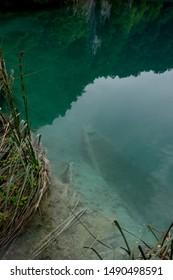 Sunken rowboat underwater in Plitvice Lakes
