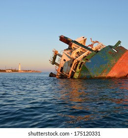 Sunken ship at sunset