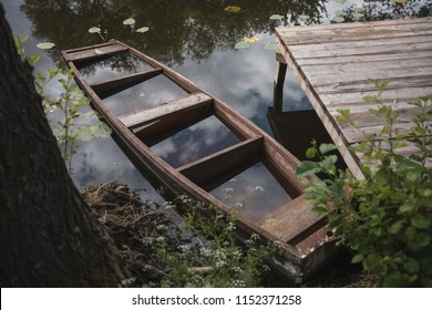 a sunken wooden boat at the pier