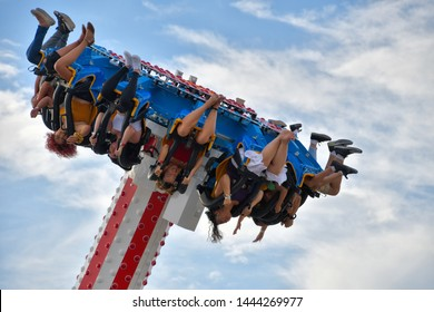 Sunland Park, New Mexico / USA - 4 July 2019 Western Playland Amusement Park The Loco 360 is an exciting ride and adrenaline booster. You will go upside down. It's not as bad as it looks.