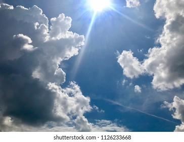 Sunlight between stormy clouds