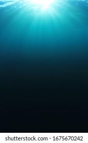Sunlight in blue water underwater photo