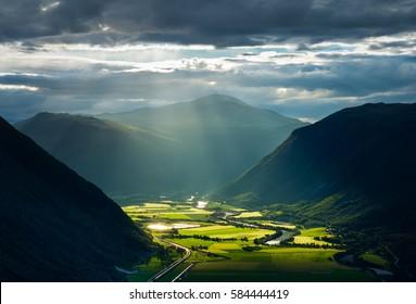 Sunlight breaking through the clouds over the valley. Gudbrandsdalen, Norway