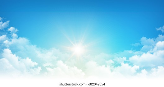 Sunlight breaking through white clouds in early morning blue sky