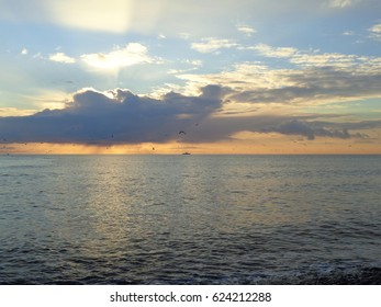 Sunlight and clouds over the sea at sunset