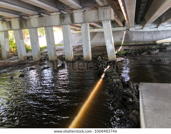 Sunlight Coming Down Through Bridge Crack Stock Photo (Edit Now