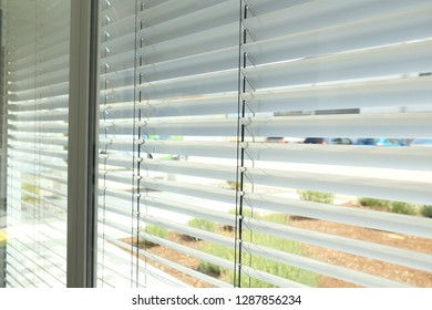 Sunlight coming through venetian blinds by the window - office