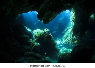 Sunlight enters underwater cave like a spotlight