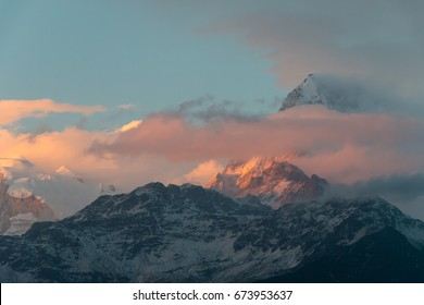sunlight in the evening is lighting the snow mountain, feeling warmth and beautiful for background