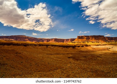 The sunlight falling on these magnificent formations in the Maze area of the Canyonlands National Park in Utah, makes them stand out in this remote and beautiful desert area.