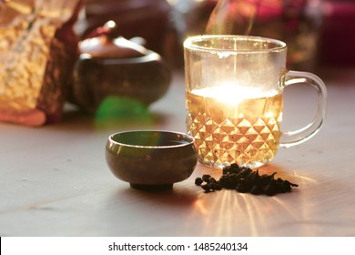 sunlight falls on a Cup of tea. Cup of tea on the table. warm soft sunlight