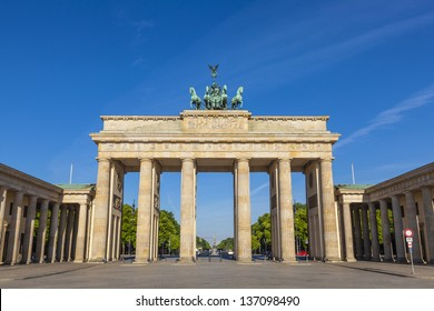 Sunlight illuminating Brandenburg Gate (1788) inspired by Greek architecture, built as a symbol of peace and nationalism, now an emblem of reunification.